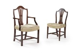 A set of twenty two mahogany dining chairs