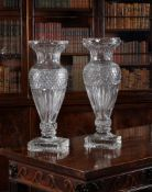 A matched pair of modern substantial cut glass baluster vases