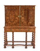 A Charles II walnut and olivewood oyster veneered cabinet on stand