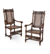 A pair of Charles II caved walnut armchairs