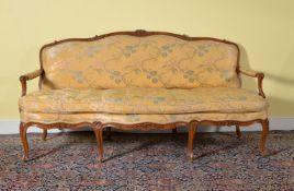 A Louis XV carved beech and upholstered sofa