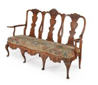 A Danish carved beech and needlework upholstered chair back settee