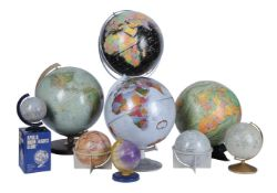 A group of four twelve-inch terrestrial globes