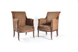A pair of walnut bergeres, of Regency style, by Frederick Parker and Sons, circa 1938 and recently