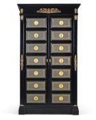 An Empire style ebonised and brass mounted armoire, 20th century, the tooled leather panelled