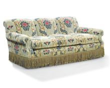 A modern sofa, 20th century, upholstered in green, red and gold cut velvet, on castors, 83cm high,