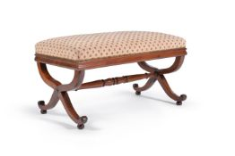 A George IV mahogany and upholstered centre stool, circa 1830, the upholstered top above x-frame