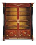 A pair of Empire style mahogany and ebonised display cabinets, late 19th century, the canted