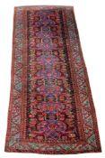 A Kurmurjur Kula carpet, the wine madder field with nine medallions, flowerheads and vines on