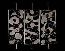 A three-section painted metal screen or room divider