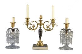 A pair of Regency cut glass and gilt and patinated bronze lustre candlesticks