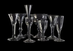 Seven assorted plain stemmed and baluster wine glasses