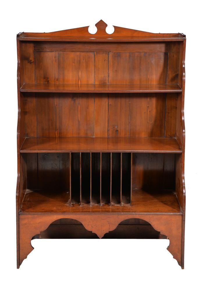 Lot 356 - A solid walnut 'waterfall' bookcase