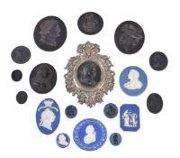 A group of eighteen various Wedgwood and Wedgwood & Bentley black basalt and blue Jasper medallions