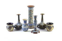 A pair of Doulton Lambeth Pottery Stoneware bottle vases