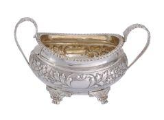A George IV silver twin handled oval sugar basin