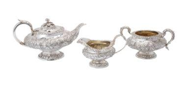 ϒ A matched George IV silver lobed circular pedestal three piece tea service