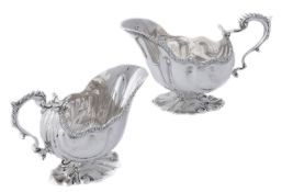 A pair of late Victorian cast silver shaped oval sauce boats by William Hutton & Sons Ltd