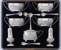 A late Victorian silver seven piece cruet set by Faraday & Davey