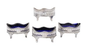 A set of four George III silver oval salt cellars by Henry Chawner