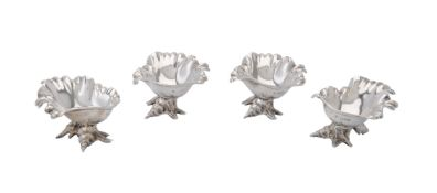 A set of four late Victorian silver shell salt cellars by William Hutton & Sons Ltd