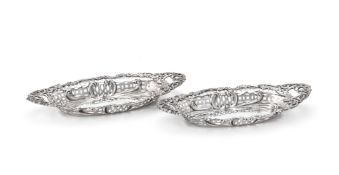 A pair of Edwardian silver shaped navette sweet dishes by Henry Matthews