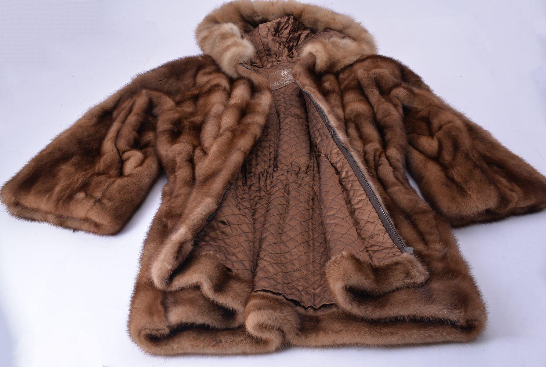 Lot 1077 - De Carlis, Roma, a fur hooded fur coat