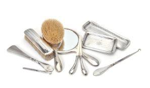 ϒ A silver mounted eight piece dressing table set by Henry Matthews