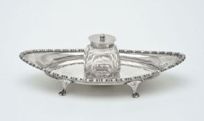A silver oval inkstand by James Deakin & Sons