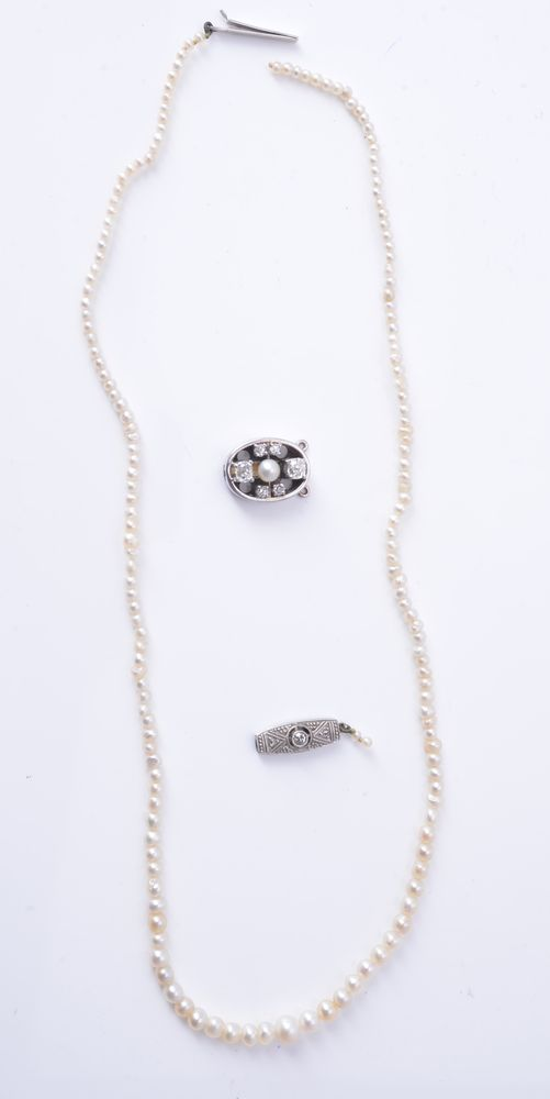 Lot 866 - A diamond and cultured pearl clasp