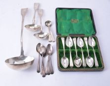 A small collection of silver ladles and spoons