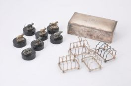 A set of four silver four division toast racks by Atkin Bros