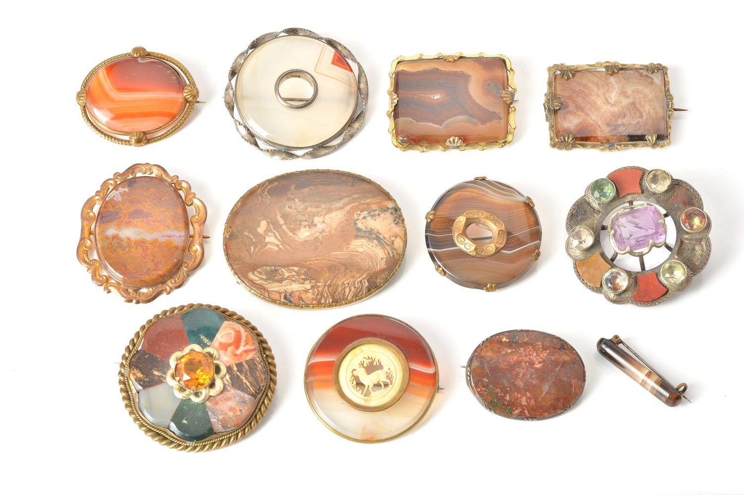 Lot 854 - A collection of twelve hardstone brooches