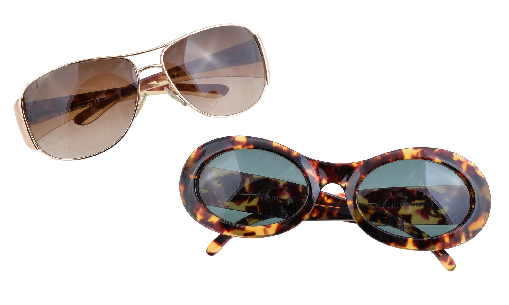 Lot 1069 - Prada, a pair of gilt and faux tortoiseshell sunglasses