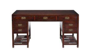A Chinese hardwood pedestal desk