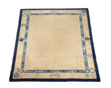 A Chinese pale yellow wool rug