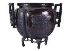 A Japanese Cast Bronze Jardiniere of lobed form decorated on the diaper ground with clouds and panel