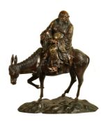 A Japanese Bronze Group of a Sage seated on the back of a Mule
