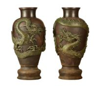 A very large Pair of Japanese Bronze Vases each of inverted baluster form on a stepped base