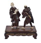 ϒ A Japanese Wood and Ivory Group in the manner of Miya-O Eisuke