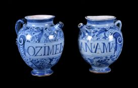 A pair of central Italian maiolica Berettino-ground wet-drug jars, late 17th century