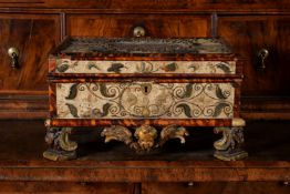 An unusual Charles II stumpwork and tortoiseshell banded work box, circa 1675