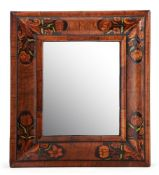 A William & Mary walnut, ebonised and marquetry decorated cushion framed wall mirror, circa 1690, at