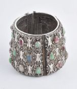 A Chinese hinged bangle of tapered form