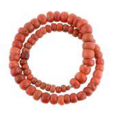 ϒ A single strand coral bead necklace