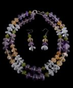 A two row amethyst, rock crystal, citrine and peridot bead necklace