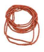 ϒ A collection of nine coral bead strands