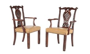 A pair of mahogany armchairs in George III Irish style