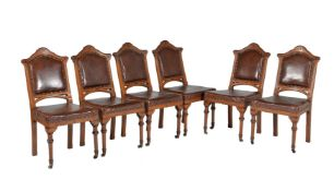 A set of six Reformed Gothic oak and inlaid dining chairs