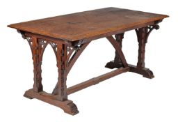 A Victorian Gothic Revival carved oak dining table